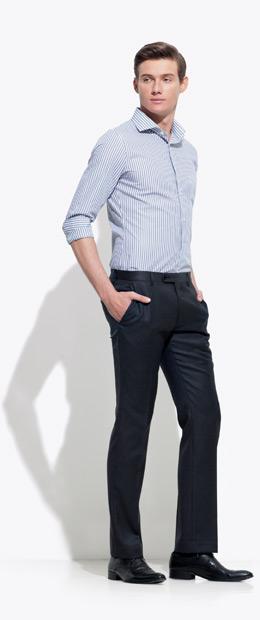 A model wearing an INDOCHINO pin-stripe custom shirt and black pants.