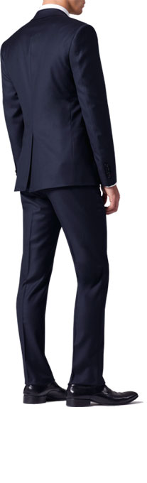A rear profile of a navy INDOCHINO suit.