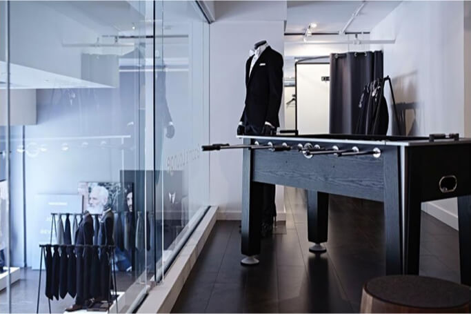 The interior of an INDOCHINO showroom featuring a game table.